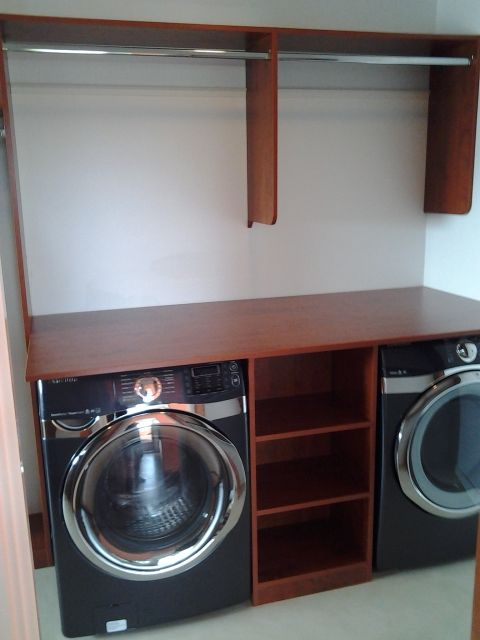 Washer and dryer in a master closet with space to hang and for Masters laundry