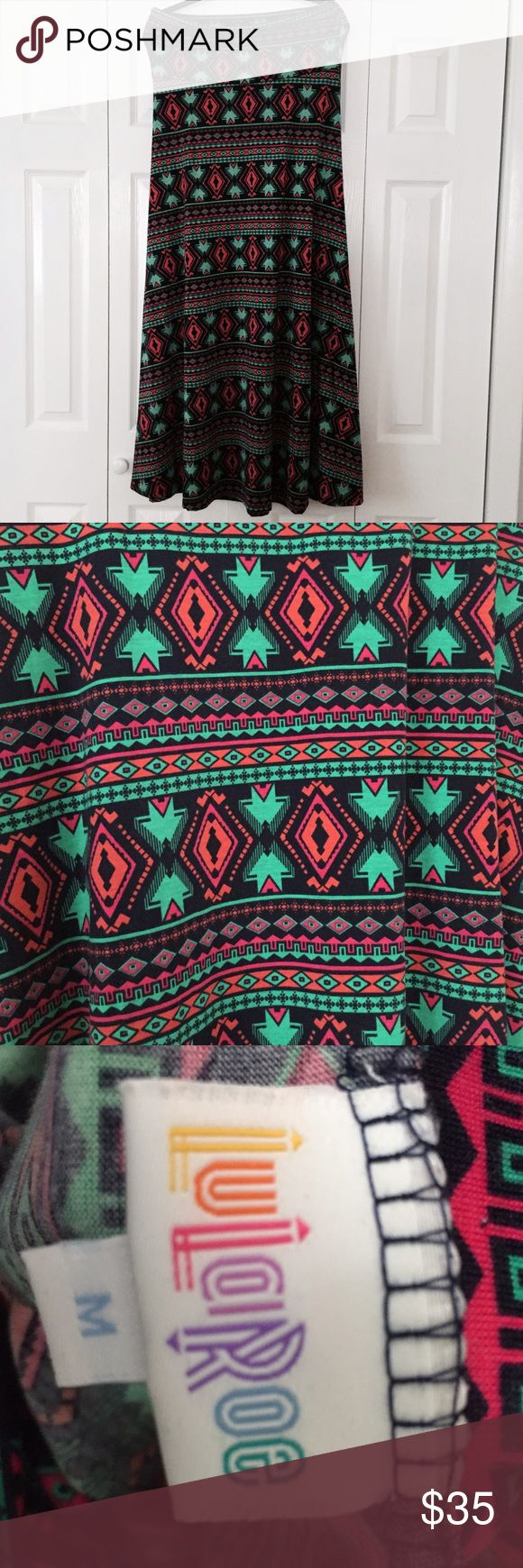 Aztec Print Long Maxi Skirt Dress LulaRoe Medium Beautiful Aztec inspired geometric print maxi skirt that can also be worn as a dress by LulaRoe. Stretchy, legging-like material. Colors are navy, pink, coral and green. Size medium. Worn and washed once. LuLaRoe Skirts Maxi