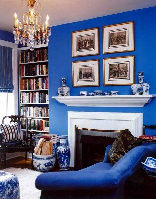 Bold blue is cool and calm. White contrasting details such as this mantle and fire surround, ceiling, window and door frames give this room a fresh feel which gives a modern edge to a traditional architectural style. Tip- When using a bold colour make connections to artwork, fabric and collections.