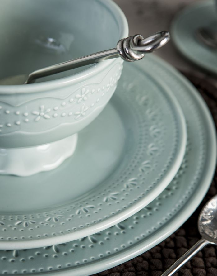 French Country's latest dinnerware range Tulle, in a duck egg blue with a delicate beaded leaf pattern.