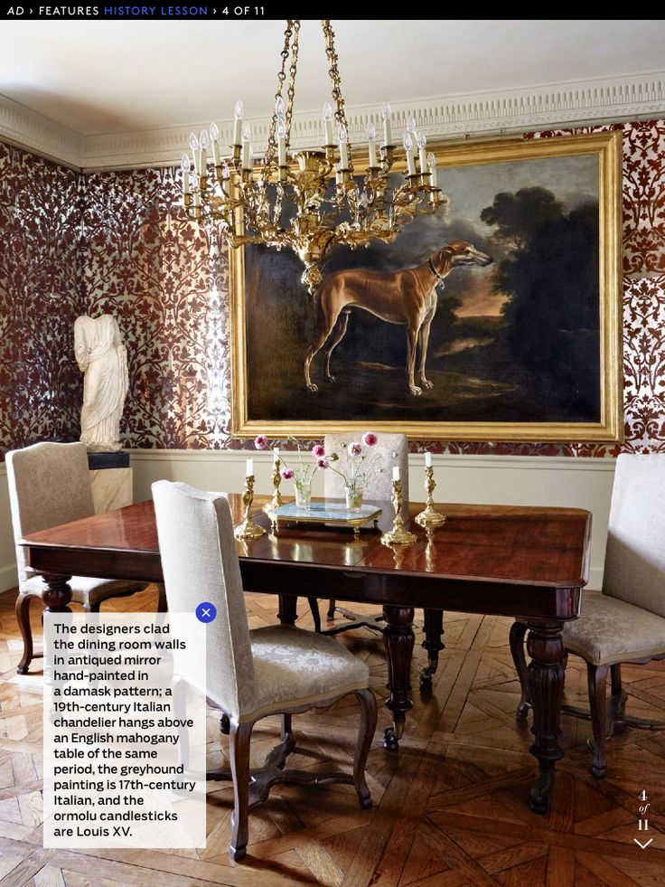 the designers clad the dining room walls in antiqued mirror hand painted in a damask pattern a italian chandelier hangs above an english mahogany table of