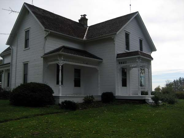 Farm style house with Victorian fretwork trim
