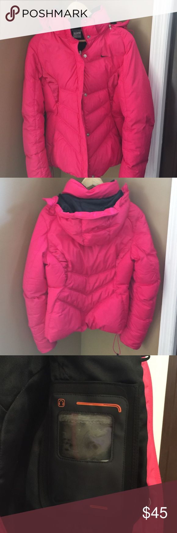 Nike winter coat Size medium. Down feathers! iPod/iPhone holder. I used this coat snowboarding and loved it for the cold weather. I am not a huge pink fan anymore and have moved into a black coat. Excellent condition, haven't worn it much. Great buy! Nike Jackets & Coats Puffers