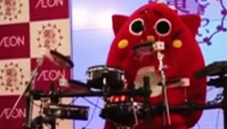 Adorable Japanese mascot drummer plays some serious death metal beats to children's songs
