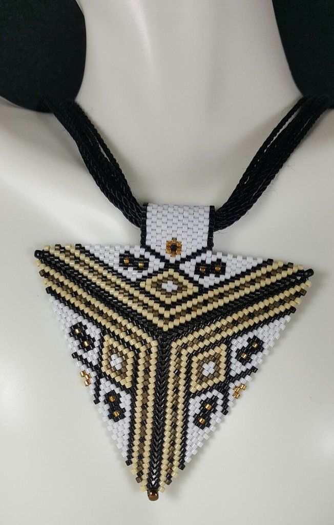 Are you looking for the perfect piece to go with just about anything you own? Well this is the piece for you. This unique triangle pendant is made in the peyote stitch with size 11 delica seed beads.