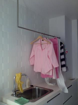 Use the Ikea hanging rack suspended from the wall and fully adjustable in length. Laundry Design Ideas by Cutlist.biz Cabinet Making
