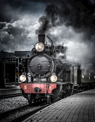 An old locomotive at the train station, Uppsala Sweden. Available as poster at printler.com, the marketplace for photo art. Photographer Johan Lennartsson.