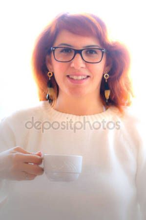 Young smiling girl is drinking tea — Stock Photo © carlotoffolo #157688094