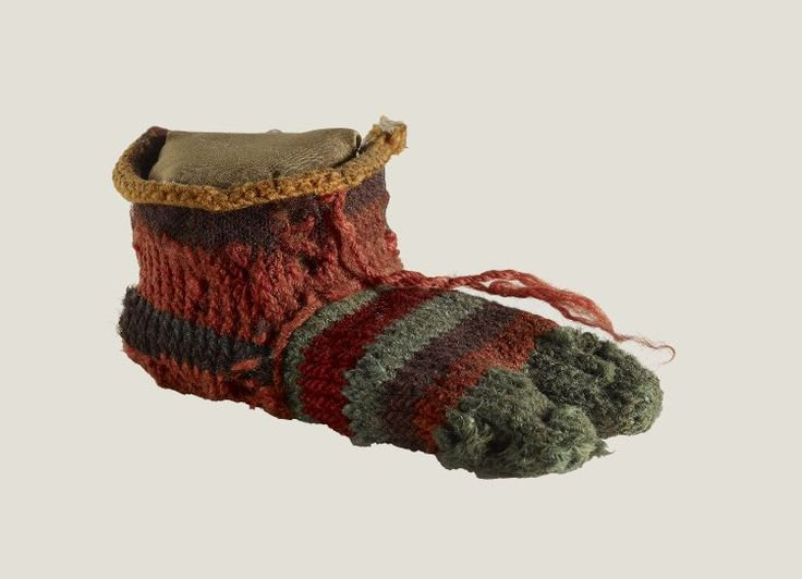 Ancient sock for the left foot of a child with separation between the big toe and four other toes worked in 6 or 7 colours of wool yarn. Late Antique Roman Period, date 200-400 (radiocarbon date).
