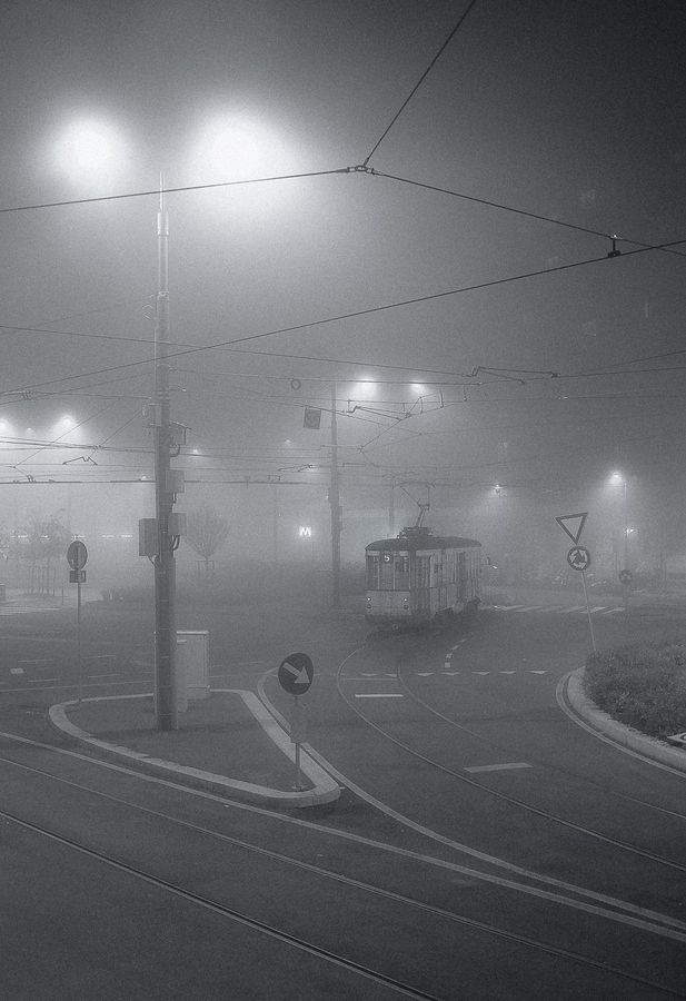 Fog in Milano during late autumn or winter is a safe assumption. This photo was taken just outside of Lambrate FS train station, You can see a tram public transport slowly making its way in the fog. S.