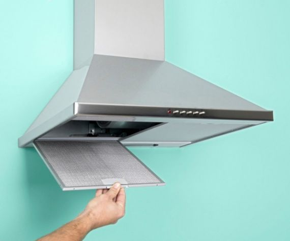 Run a greasy hood filter through the dishwasher, or buy a replacement if the screen is very dirty and clogged.