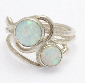 sterling silver wired ring set with 6mm and 8mm stunning white opal stones. Handmade in the UK by Lavan Jewellery.