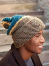 Rist is a playful hat that is sure to keep you warm this winter. It is striped in three colors and features a pom pom on top!  Rist | Berroco Purl in the Pines carries both Peruvia yarn and pom-pom makers -- stop in to check colors!