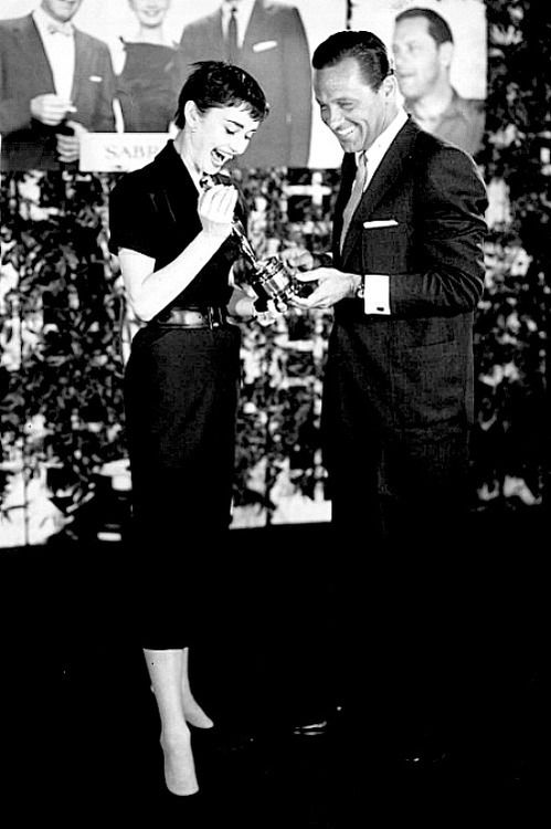 Audrey and William Holden are awarded the Academy Awards for Leading Actors, 1954.