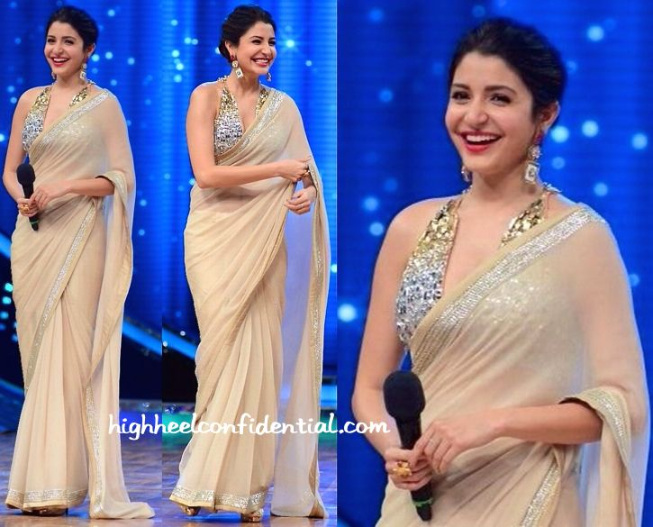 While on the sets of a television show, Anushka was photographed in an Abu Jani Sandeep Khosla sari. An updo, big earrings and cocktail ring finished out her look. It's not very often that we see a sari on Anushka so it sure made for a welcome change of pace. Though the blouse isn't our …