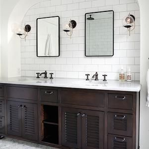 white subway tile in shower, carrara marble counter and floors ..with oil rubbed bronze fixtures and dark vanity ….like