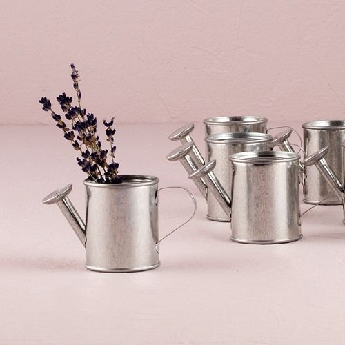 These marvelous mini watering cans will help your love blossom. Complete with spout and handle, they make great garden-themed favors.  Fill it with candy or tiny flowers for your outdoor bridal shower, baby shower or spring wedding.