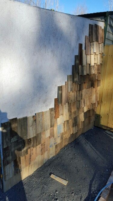 Day 3 pallet shingles siding on lean to from my shop.