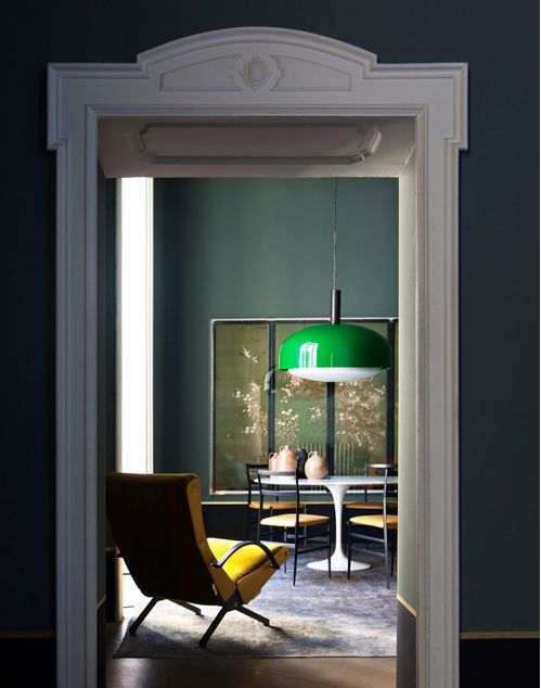 Green pendant and yellow chair