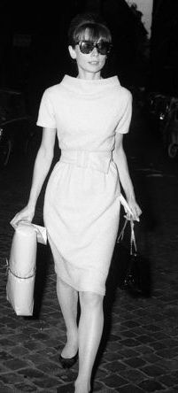 Audrey Hepburn shopping in Rome in 1964, wearing Givenchy.