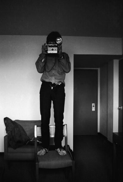 """The ? that went with this pic was """"what was George taking a picture of, standing on a chair in a hotel room w/his pants unfastened?"""""""