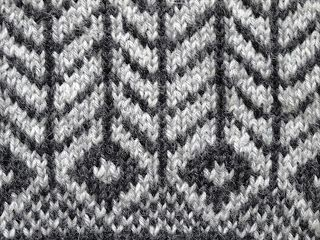 Black and white graphic sweater, hem detail