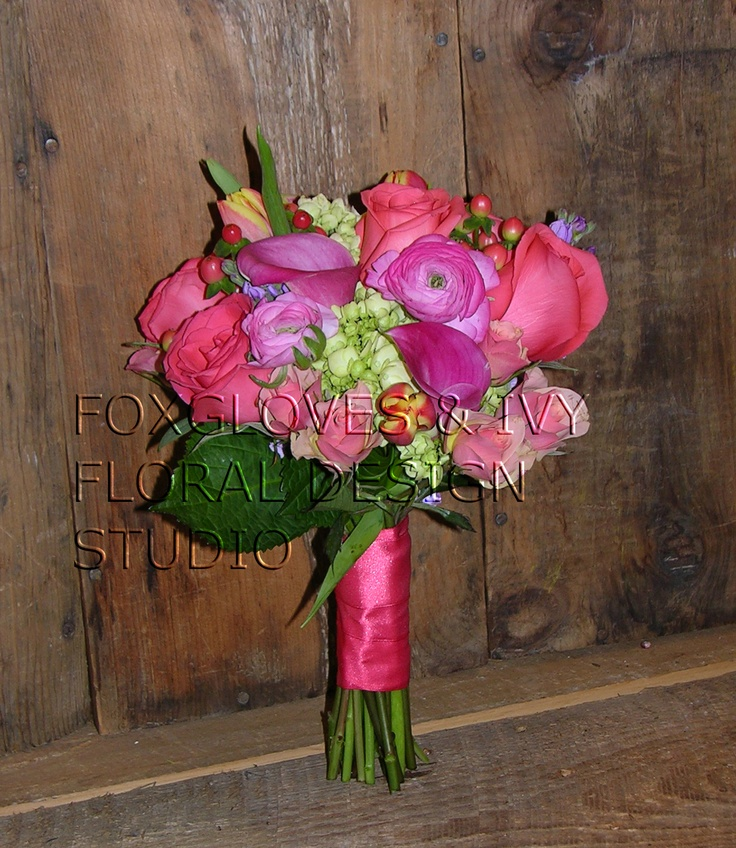 Katie's bridesmaid bouquet.. coral is her favorite color..  we used 'Movie Star' & 'Geraldine' roses, hypericum berries, Baby Green hydrangea, coral bi-colored Dutch tulips, 'Garnet Glow' miniature callas, pink ranunculus and lavender Lisianthus...