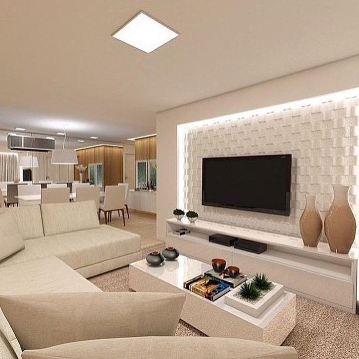 """""""Sobre layouts inteligentes  sofá em """"L"""" para delimitar espaços em ambientes integrados... O painel da TV também está , com revestimento 3D emoldurado…"""""""