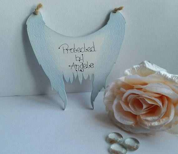 Check out this item in my Etsy shop https://www.etsy.com/uk/listing/521980453/memorial-angel-wings