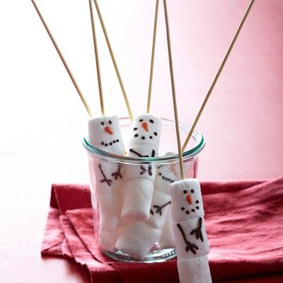 A very cute idea! For those of us not willing to pay $13 for 4 skewers, these could easily be made with food color markers.-Veronica Williams-Sonoma Marshmallow Snowmen on Sticks, Set of 4 #williamssonoma