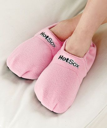 HotSox Therapeutic Slippers.   Heat them or freeze them! These sound great. 6.95 a pair. Blue or Pink. They aren't the most fashionable things but they do warm my feet up! LOVE mine.