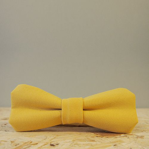 Handmade bow tie made from old clothing and leftover garments.
