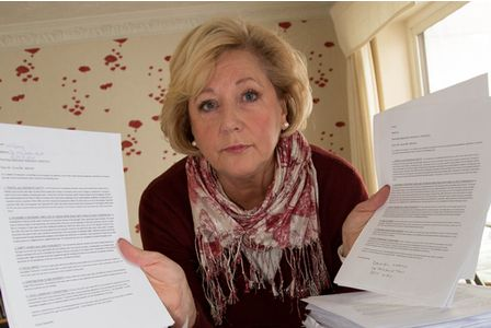 Vivianne Snape, a member of Stonydelph Residents' Group, is pictured with the stack of objection letters against housing plans on land off Pennine Way.  TAAB301112-03