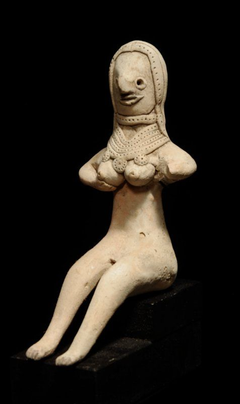 Indus Valley pottery enthroned Mother Goddess, Oxus Civilization, 2600-2500 B.C. A delicate buff clay effigy figure, sits with stylized facial features, large full breasts, fine ringlet hairdo and necklaces, 10.8 cm high. private collection