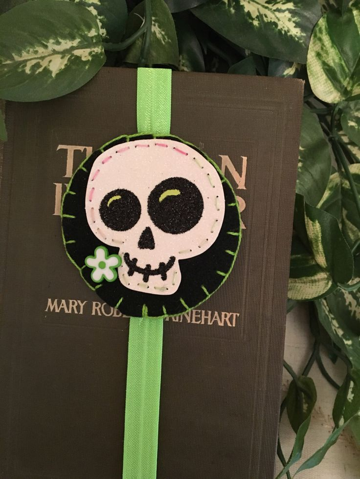 A personal favorite from my Etsy shop https://www.etsy.com/listing/472197880/green-sugar-skull-felt-bookmark