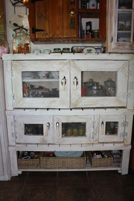 Pallets abd old cutlery used forvthis cupboard