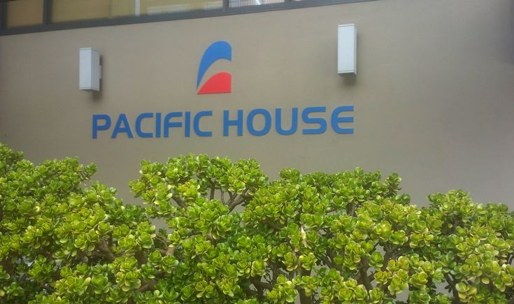 Digitally printed graphics applied to existing cut letters for Pacific House by Speedy Signs Newton
