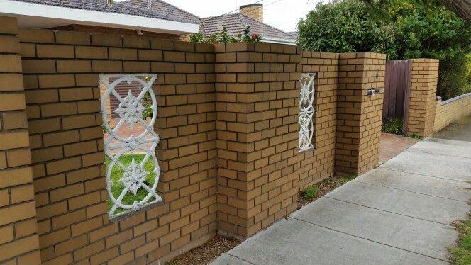 Yellow brick fence,  tan , white metal detailing