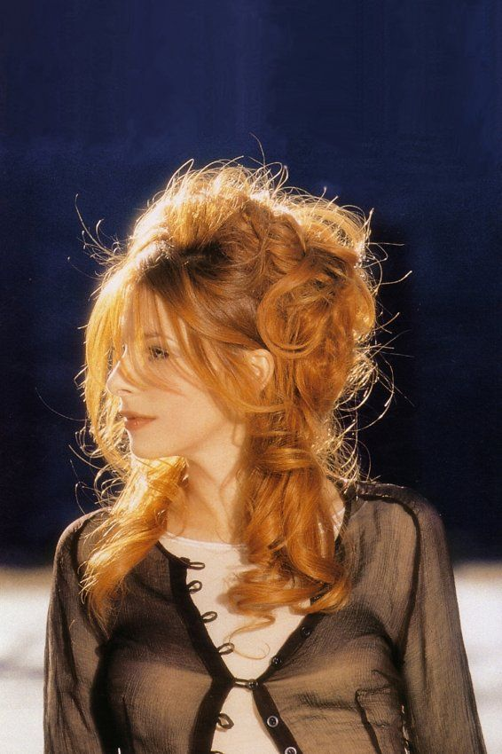 Mylène Farmer 1999 by Claude Gassian