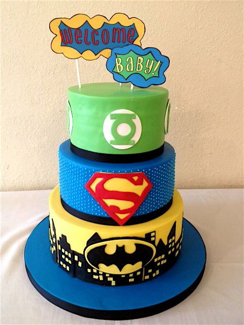 AppleMark super hero baby shower cake.  The toppers are made of paper.