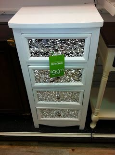 Small shattered mirror pieces on the drawers of a small dresser. Great idea for refurbishing junk/outdated furniture.