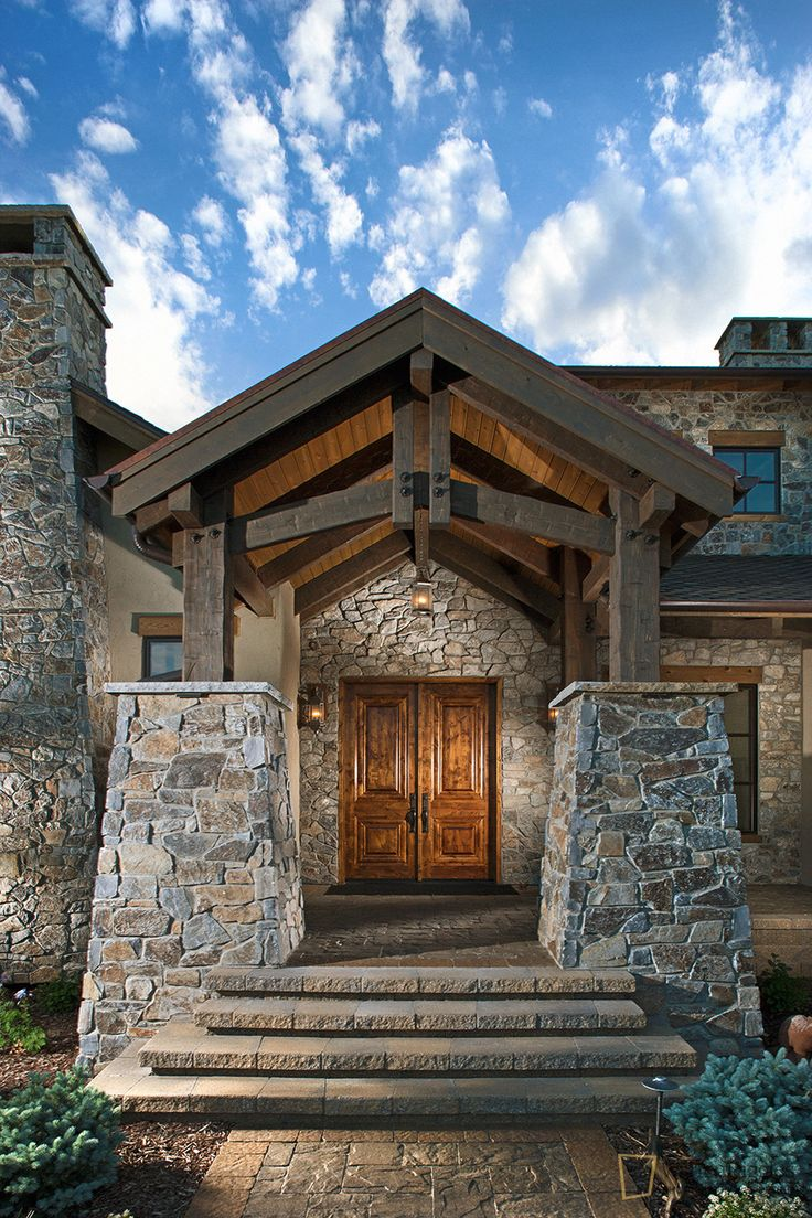 colorado luxury home exterior stone entryway home built by brannen home architecture by rentfrow