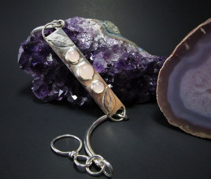 A stunning sterling silver bar bracelet with Rose Quartz gemstones by Allura Natura. Click to shop!