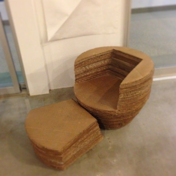 cardboard furniture design. it could be a table or pull the middle out and its chair cardboard furniture design r