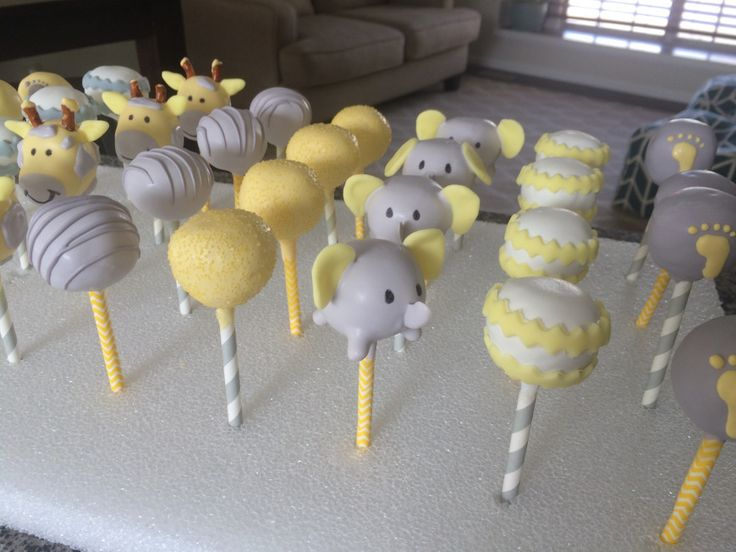 baby shower cupcakes gray and yellow with baby elephants and giraffes