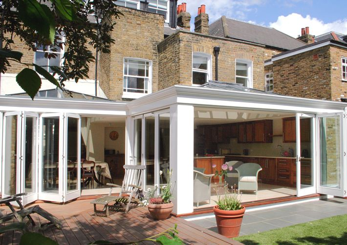 Kitchen and Family Room Orangery with folding sliding doors, London