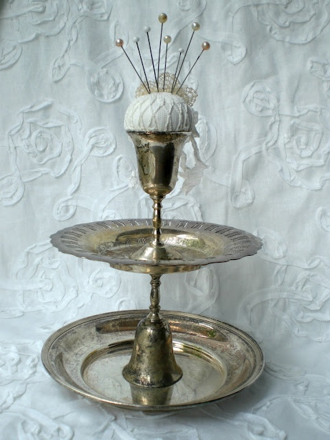From Todolwen ~ silver plated goblets and trays ~ love this idea for stowing sewing items