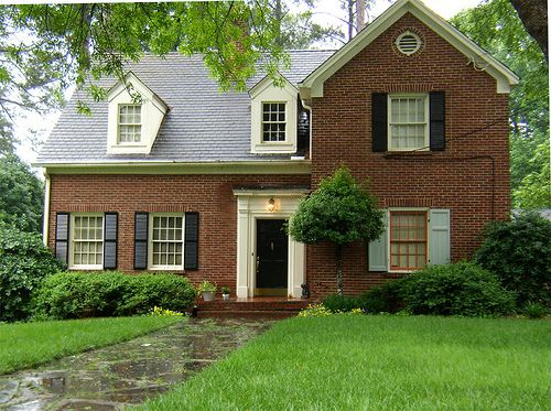 Brick house with black shutters google search home Black brick homes