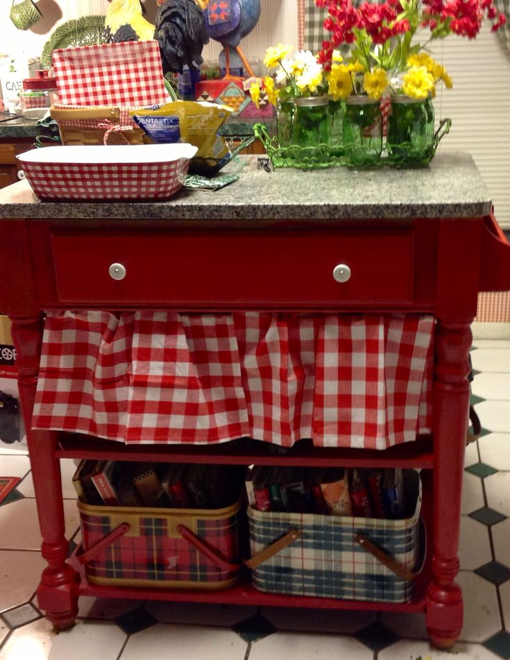 small country table painted red, how cute with the check around the bottom <3