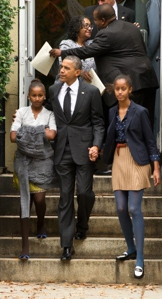 Presidents Barack Obama and his daughters leaving church...